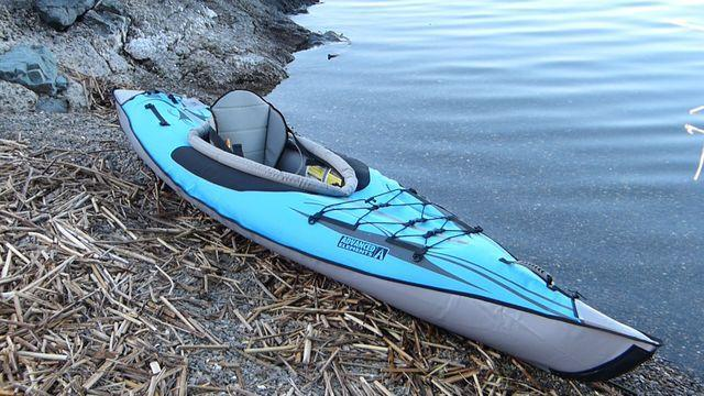 The best inflatable kayak on a river bank