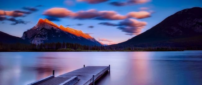 Lake view of banff national park with a pink haze
