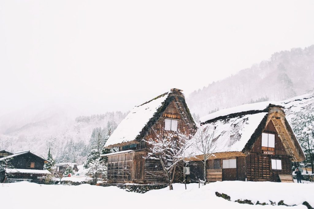Snow covered ski chalet, made from wood
