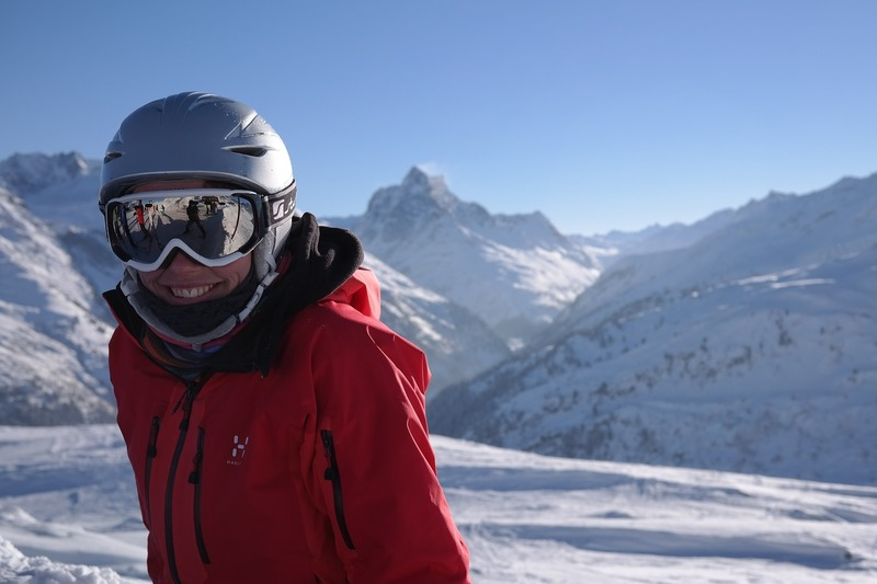 Smiling woman in ski helmet