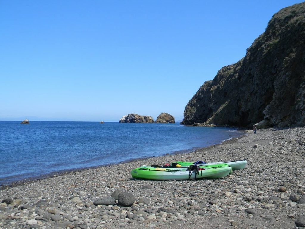 Sit on top kayaks on the shore