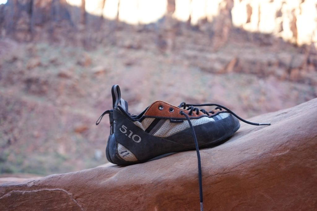 climbing-shoe-resting-on-rock