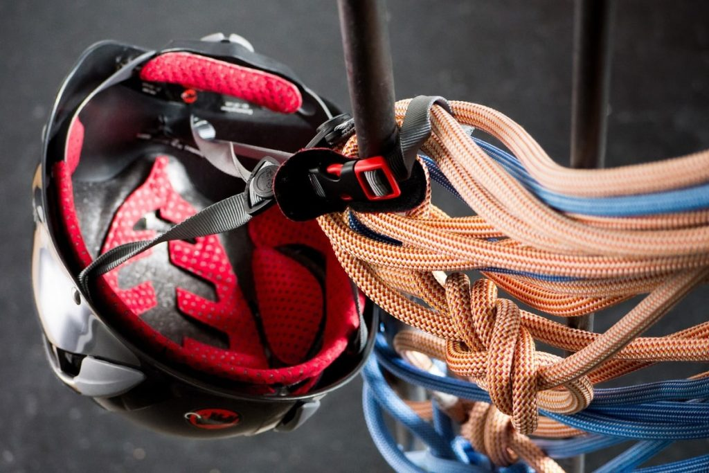 Red helmet and climbing ropes