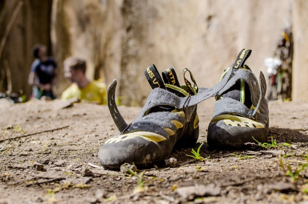 Climbing shoes with people in the background
