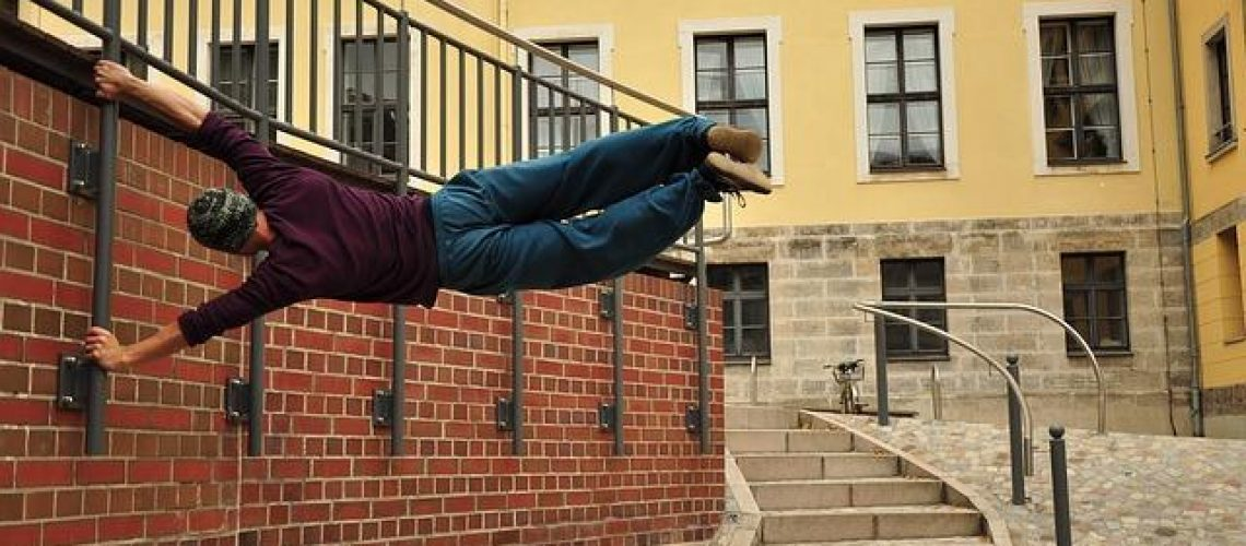 man-doing-parkour-in-pants