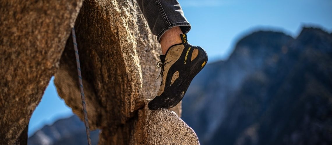 person-rock-climbing-shoe